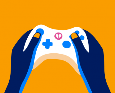 Hands holding a gaming controller